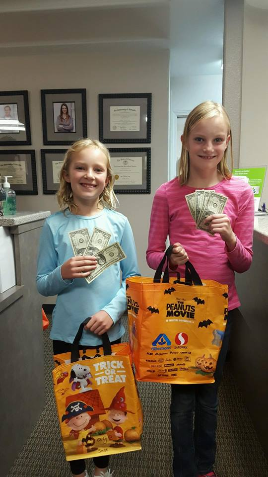 Two children participating in Operation Gratitude Candy Buy Back at Lydiatt and Duru Family Dentistry.