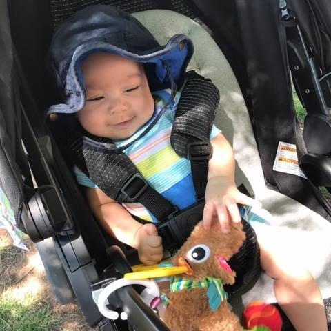 A smiling baby at the Colorado Springs Family Friendly Beer Festival.